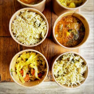Steaming rice and curries in containers